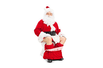 Santa Claus posing seated on a toilet