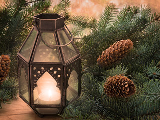 Christmas Lantern and spruce branches with cones