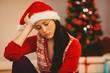 Festive brunette feeling sad at christmas