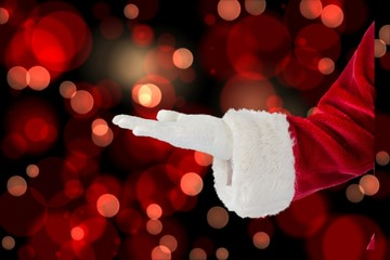 Composite image of santa claus presenting with hand