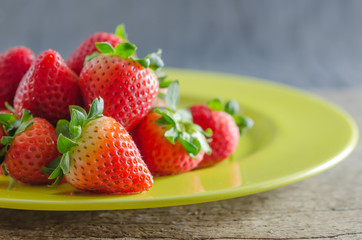 red strawberries on dish