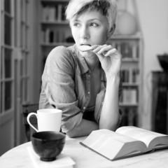 Intimate portrait of beautiful woman having breakfast at home. B