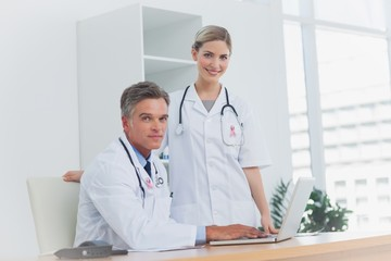 Composite image of medical team at the office