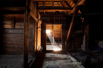 Ray of light at old roof space attic