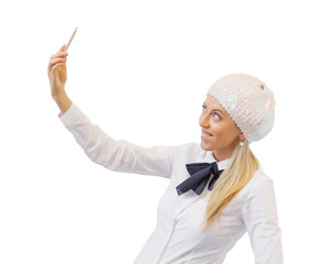 Fashionable woman making selfie photo with mobile phone