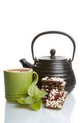 teapot, cup and and chocolate
