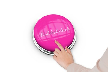 Hand pressing pink button for breast cancer awareness