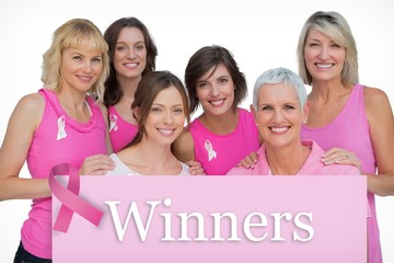 Women posing and wearing pink for for breast cancer