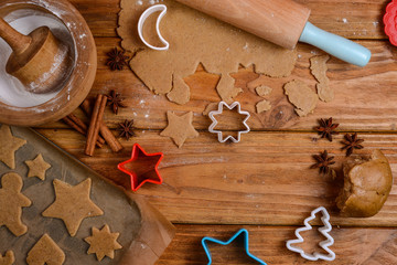 Cutting Christmas cookies on table