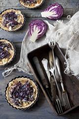 homemade purple cabbage rustic quiche and box with silverware