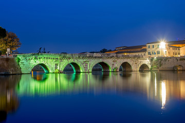 Rimini. Twilight on historical Tiberius bridge.