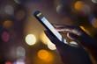 Leinwanddruck Bild - Woman using her mobile phone , night light background