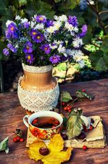 bouquet of wild flowers in a pot in the garden