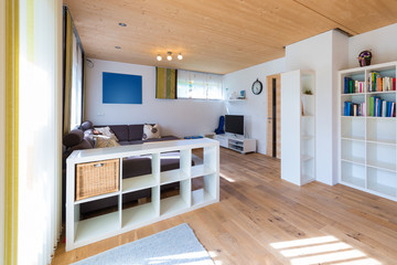 indoor shot of living room with wooden floor in a timber house
