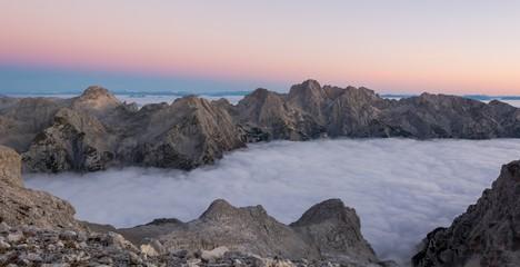 Mountain ridge above clouds