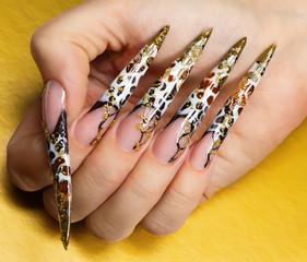 Beautiful nails on yellow background.