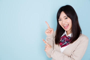 young asian woman on blue background