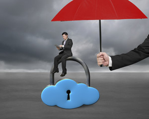 red umbrella protect businessman using tablet on cloud lock
