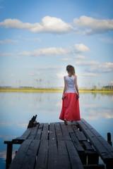 Beautiful woman on bridge on Lake