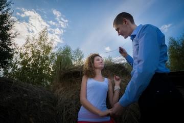Happy couple in haystack summertime