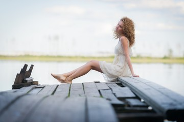 Beautiful woman on bridge on Lake
