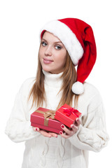 Beautiful woman wearing a santa hat smiling with gifts