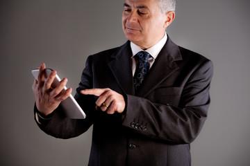 Senoir man using successfully a tablet