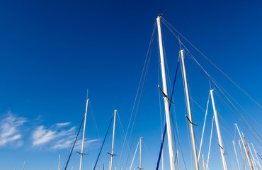 Looking up at the mainmasts of a yacht.