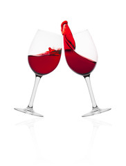 Wine glasses in with splash of wine