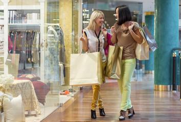 Two women shopping for fashion clothing