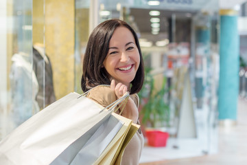 Young woman carry shopping bags while shopping