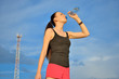 Woman drinking water from bottle