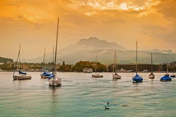 Yachts in Lucerne at sunset, Switzerland
