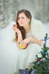 Woman eating a candy in winter forest