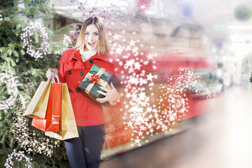 Young woman is running inside a Christmas gifts shop