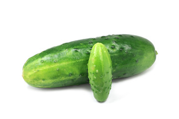 large and small cucumber on white background