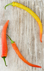 Red and yellow peppers background