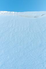 Snowdrift against the blue sky