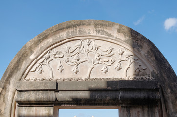 bas relief at the top of gate in taman sari water castle