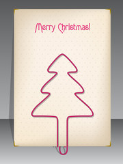Christmas greeting with christmas tree shaped paper clip
