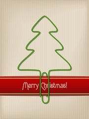 Striped christmas greeting with tree shaped paper clip