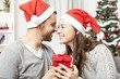 young couple is happy with gift for christmas