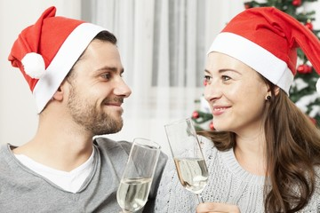 young christmas couple with champagne