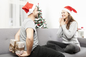 man surprise girlfriend with christmas gift