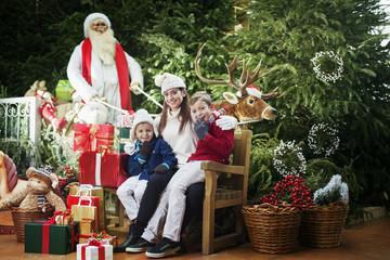 Here comes Santa Claus, family surprise