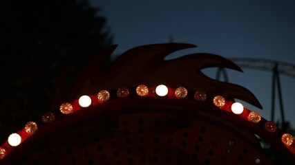 glowing elements of the carousel in an amusement park