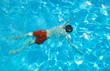 teen dives in the pool