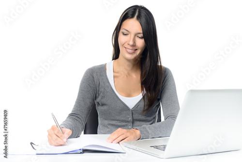 canvas print picture Freundliche junge Frau arbeitet am Schreibtisch