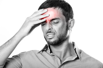 Young Man suffering Headache and migraine in pain expression