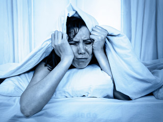 young woman in bed suffering stress insomnia sleeping disorder